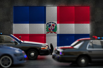 Bright digital display Dominican Republic flag in city as cars drive past