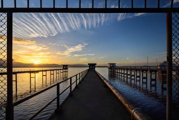 The bridge into the lake with sunrise sky
