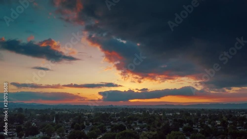 Fotobehang Aerial hyperlapse of beautiful dramatic cloudy sunset sky over San Fernando Valley cityscape. Los Angeles, California.