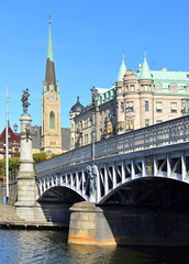 Oscar's church (Oscarskyrkan) 1903 and Yurgordsbrun beautiful arch bridge (1897) to island Yuogorden. Stockholm, Sweden