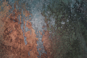 grunge metal texture covered with multicolored partially peeled paint closeup grunge background