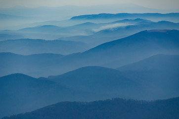 Beautiful morning alpine landscape with tonal perspective in blue tonality