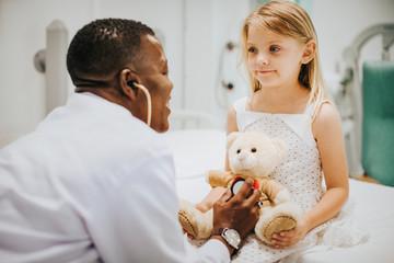 Doctor doing a health checkup on a teddy bear