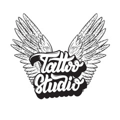 Tattoo Studio. Vector handwritten trendy lettering with hand drawn illustration of wings. Template for card, poster, banner, label, print for t-shirt, logo design.