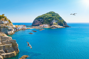 Giant green rock near small town Sant'Angelo on Ischia island, Italy