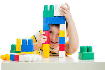 funny child boy playing with toys, isolated on white background