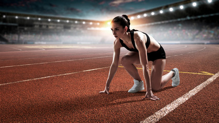 Fototapeta Female athlete ready to run. Mixed media obraz