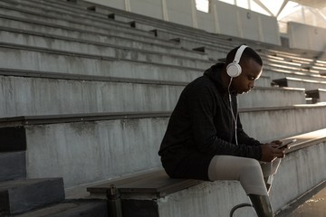Disabled athletic listening music on mobile phone