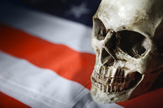 Human skull against american flag