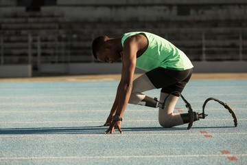Side view of disabled athlete getting ready for race