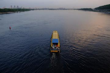 small pleasure ship on the river in Kyiv