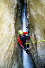 Canyoning in Gorgonchon Canyon, Spain.