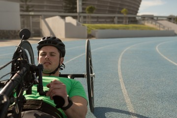 Disabled athlete racing in wheelchair