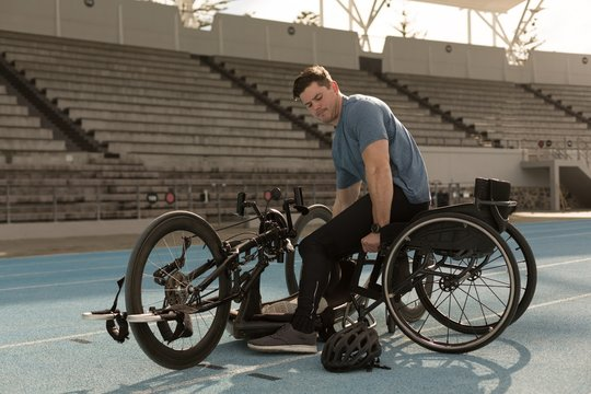 Disabled athlete sitting on wheelchair at racing running track