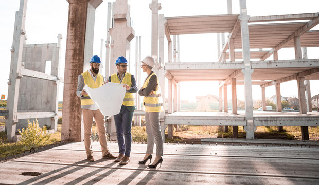 The two architects are trying to explain to their female boss why much has not been done yet.