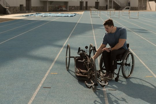 Disabled athlete with wheelchair on racing running track