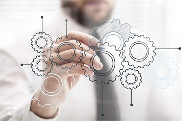 Man drawing gears, business concept