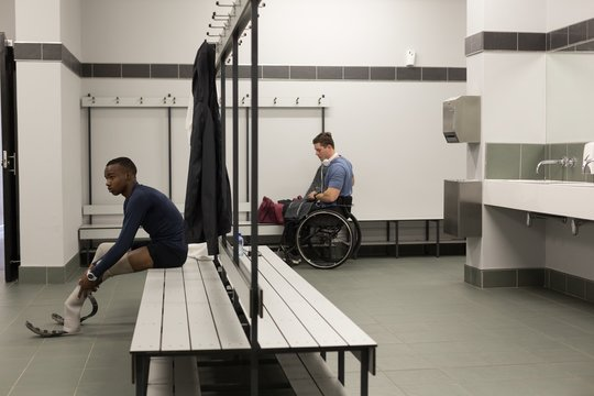 Two disabled athletes relaxing in changing room
