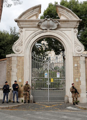 Italian Army and police stand in front of Holy See Embassy to Italy where workers had discovered human bones in Rome