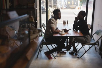 Couple looking at each other in cafe