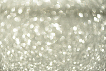 Silver abstract bokeh lights. Defocused background with copy space. New year and Christmas concept. Greeting card