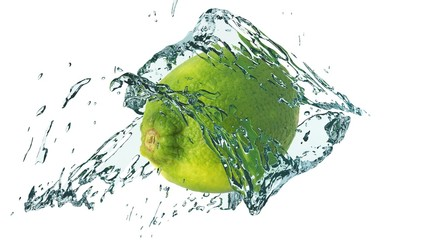 Splashing water around a lime isolated on white