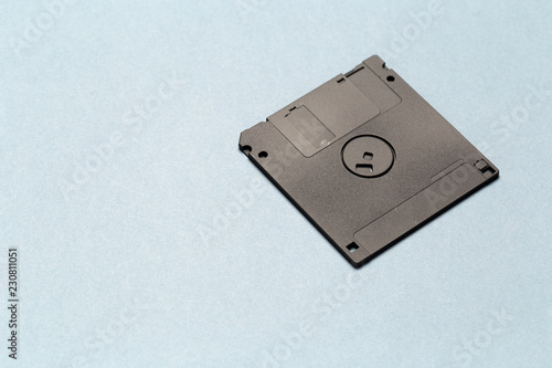 ee675a5ed Black floppy disk on light gray background close up