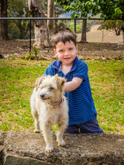 Small boy with his Jack Russel Terrier dog.