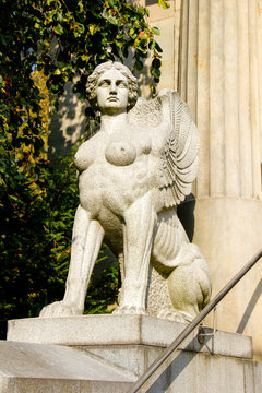 Ancient stone sphinx is a female monster with the body of a lion, the head and breast of a woman, eagle's wings and, a serpent's tail. Ancient part of a mausoleum in Germany from 1840 AD.