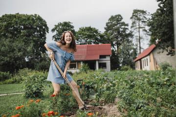 Portrait of happy woman working in garden