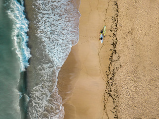 Indonesia, Bali, Aerial view of Pandawa beach, two surfers