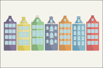 Set of colorful houses in a row on a white background.