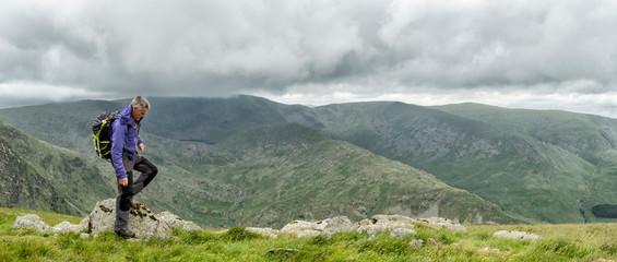 UK, Lake District, Longsleddale valley, mature man with backpack in rural landscape