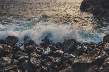 Bautiful sunset on Tenerife, with waves and stones