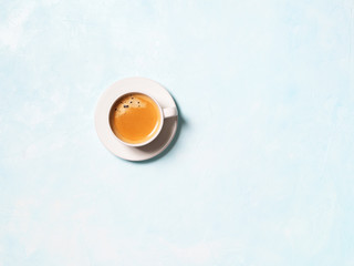 One cup of coffee espresso on a blue pastel background with space for text. Flat lay.