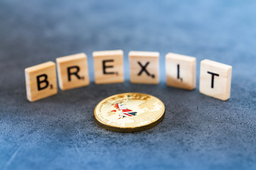 Brexit Concept - National Flag Gold Coin and English Words