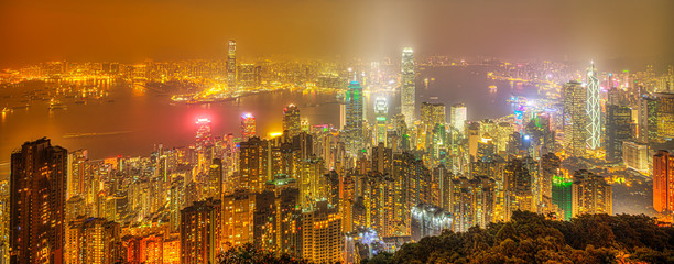 Foto op Aluminium Hong-Kong Hong Kong night panorama wide view of Victoria Harbour skyline from Victoria Peak. The Peak is the highest mountain in Hong Kong Island of China.