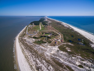 Drone/Aerial photograph of Fort Morgan.  A Civil War fort located at the end of the Gulf Shores peninsula, the entrance to Mobile Bay.  Alabama, USA