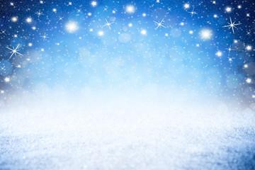 christmas xmas blue snow bokeh background with many shiny stars lights with copy space / Weihnachten hintergrund blau sterne lichter bokeh schnee leer mit textfreiraum
