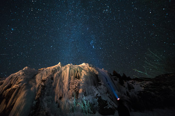 Wall Mural - A woman admires the Milky Way above the frozen Colorado Rocky Mountains