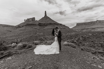 Asian/Vietnamese Bride with White Groom Posing for Wedding Photos in the Barren Utah Desert of Castle Valley, Near Moab.