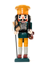 Merry Christmas: Traditional colorful vintage wooden nutcracker doll puppet in green yellow uniform isolated on white background and copyspace for text - concept tradition festive Christmas decoration