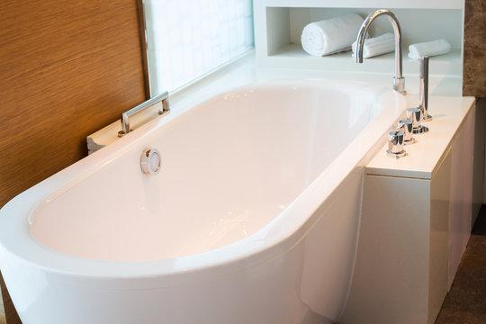 Bathroom interior in cozy colors with modern bathtub