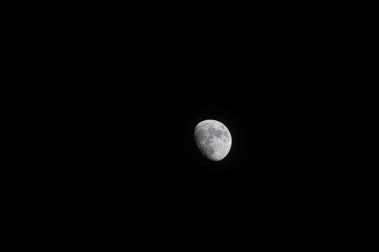 Waxing gibbous moon in the dark night sky