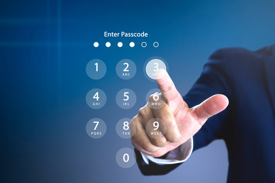 Businessman entering security passcode or password on a virtual login keypad screen to login to an encrypted computerised database system personal account