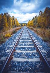 Spoed Fotobehang Spoorlijn Autumn railway view from Sotkamo, Finland.