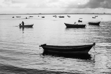 Black and white photo, fishermen are fishing out in the morning.