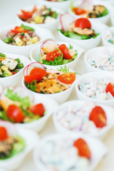 Catering and snacks on the table prepared for guests and participants of events.