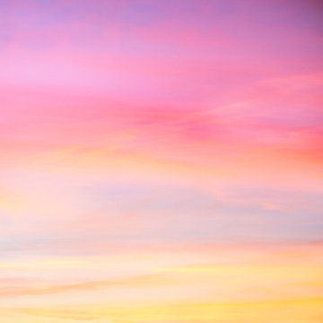 Sky in the pink and blue colors. effect of light pastel colored of sunset clouds