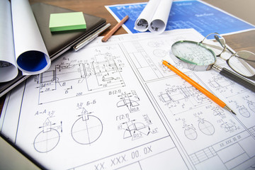 Architectural blueprints - drawings, pencil, calculator, calculations, plan, ruler, computer. Business and science.